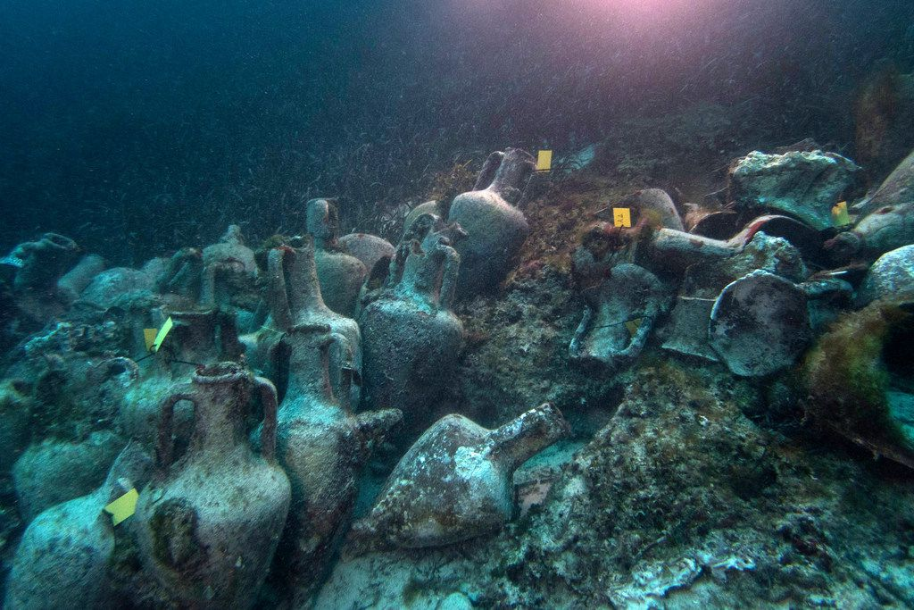 Ancient amphoras, or vases, line the sea floor at the site of the shipwreck, which dates to the 5th century B.C.