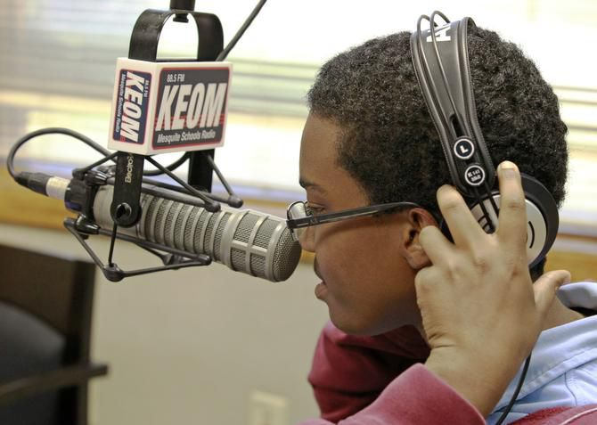Michael Holland, a 17-year-old student at West Mesquite High School, puts on his headphones before going on the air at KEOM-FM (88.5) in Mesquite.