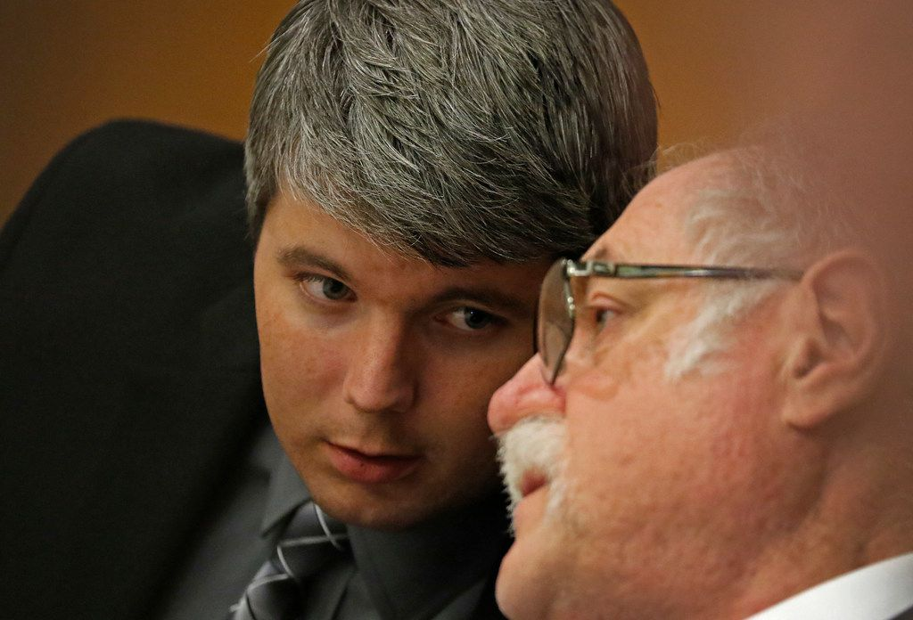 Defendant Jason Lowe (left) talks with his attorney Andrew Farkas during his murder trial at the Collin County Courthouse in McKinney, Texas, Tuesday, Sept. 19, 2017.