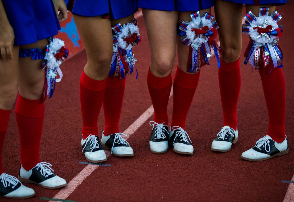 Not all mums are huge. Richardson Pearce cheerleaders showed off their homecoming mums before their game against Richardson at Eagle Mustang Stadium in Richardson.