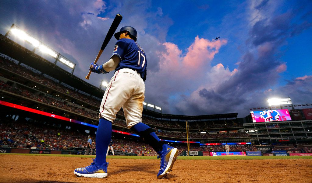 Texas Rangers left fielder Shin-Soo Choo (17) leads off against the Houston Astros rain clouds approach Globe Life Park in Arlington, Texas, Saturday, July 13, 2019. (Tom Fox/The Dallas Morning News)