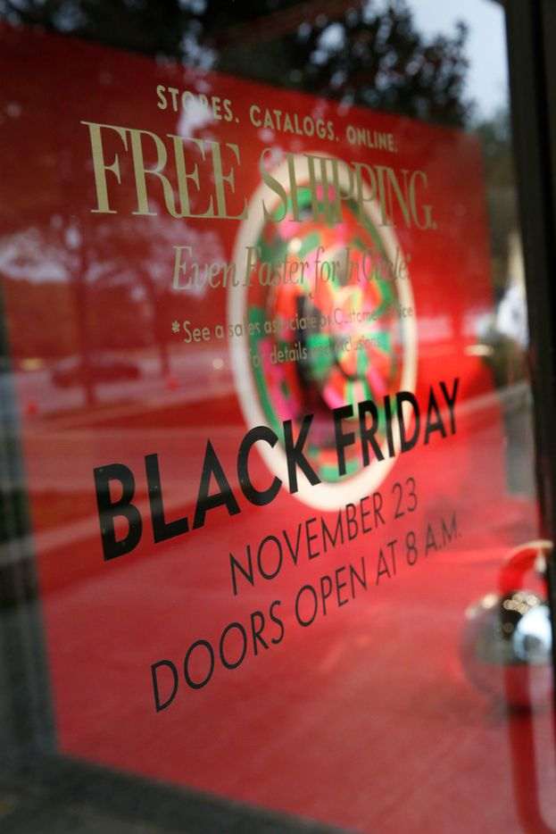 A sign for Black Friday sales on the front door at Neiman Marcus in the NorthPark Center in Dallas on Nov. 23, 2018. (Nathan Hunsinger/The Dallas Morning News)