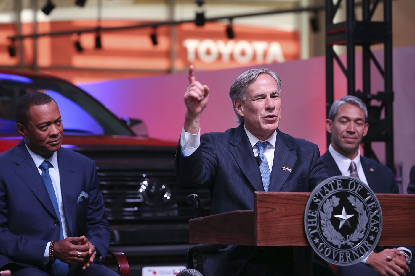 Texas Gov. Greg Abbott speaks during an event at the San Antonio Toyota plant, Tuesday, Sept. 17, 2019. Behind Abbott are Toyota Motor North America Chief Administrative Officer Christopher P. Reynolds, left, and San Antonio Mayor Ron Nirenberg, right.