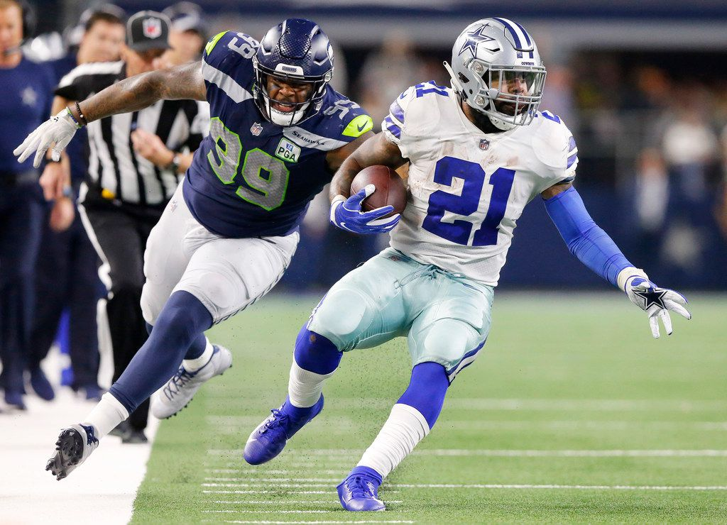 FILE - Cowboys running back Ezekiel Elliott (21) outruns Seahawks defensive end Quinton Jefferson (99) on a big run in the NFC wild-card game at AT&T Stadium in Arlington on Saturday, Jan. 5, 2019. (Tom Fox/The Dallas Morning News)