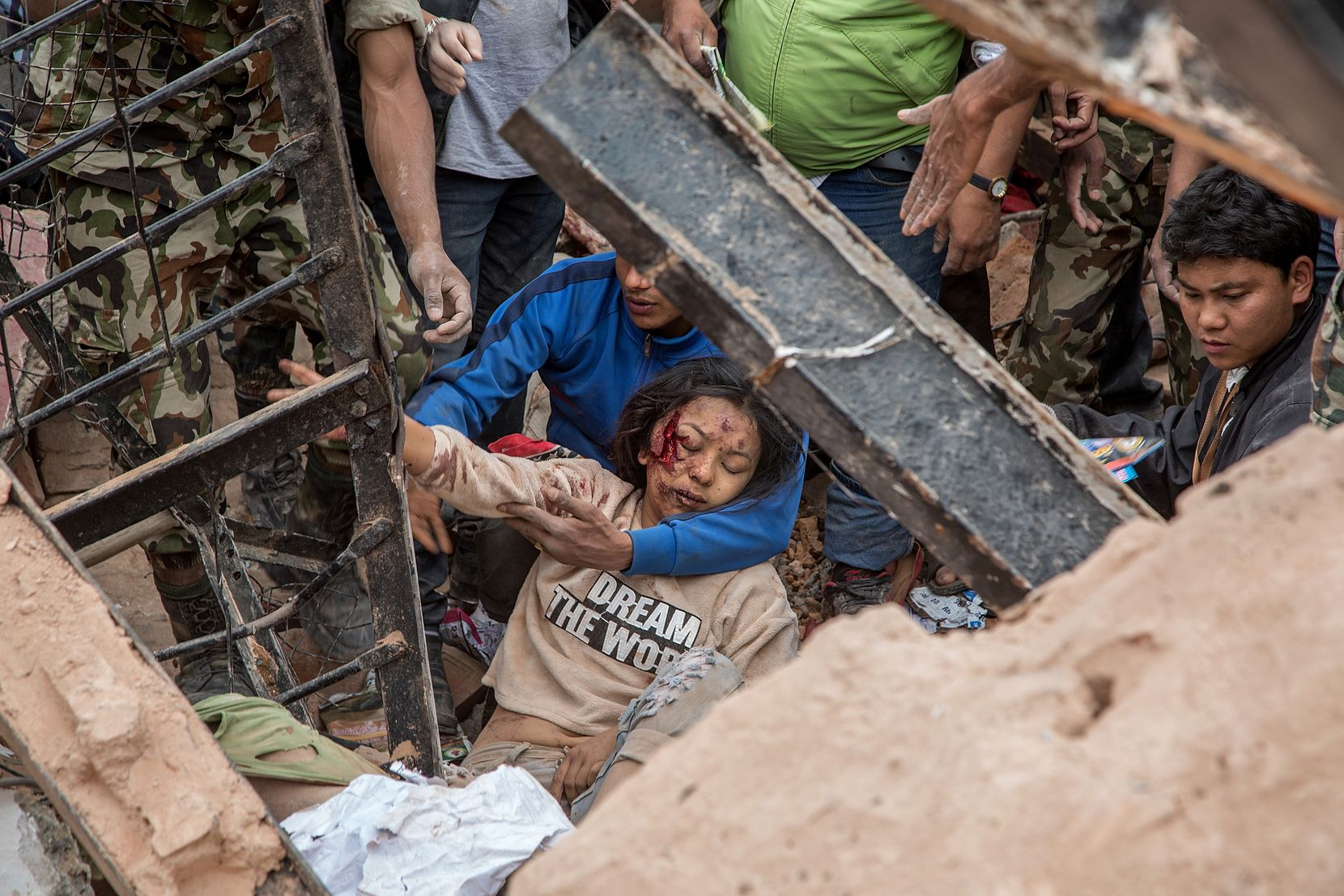 KATHMANDU, NEPAL - APRIL 25: (EDITORS NOTE: Image contains graphic content.) Emergency rescue workers find a survivor in the debris of Dharara tower after it collapsed on April 25, 2015 in Kathmandu, Nepal. More than 100 people have died as tremors hit Nepal after an earthquake measuring 7.9 on the Richter scale caused buildings to collapse and avalanches to be triggered in the Himalayas. Authorities have warned that the death toll is likely to be much higher. (Photo by Omar Havana/Getty Images) *** BESTPIX ***
