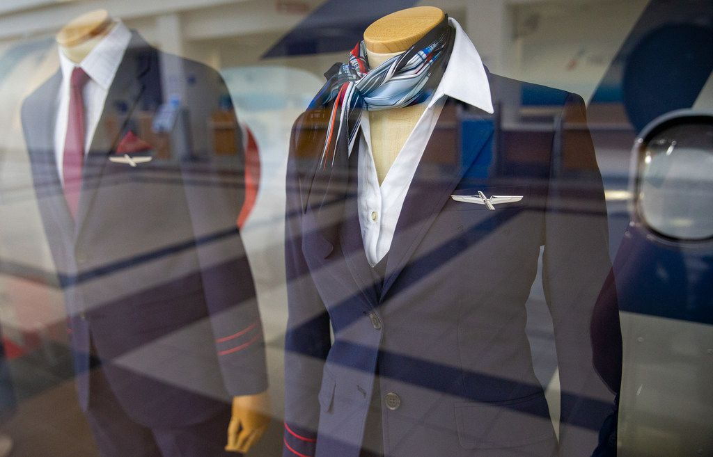 A display case features the newest collection of flight attendant uniforms at the new American Airlines campus and headquarters in Fort Worth, Texas, on Monday, Sep. 23, 2019. (Lynda M. Gonzalez/The Dallas Morning News)