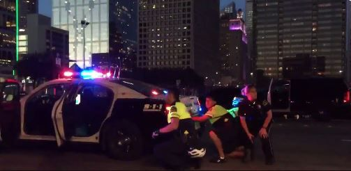 Police respond after multiple shots were fired during a Black Lives Matter Protest in downtown Dallas.