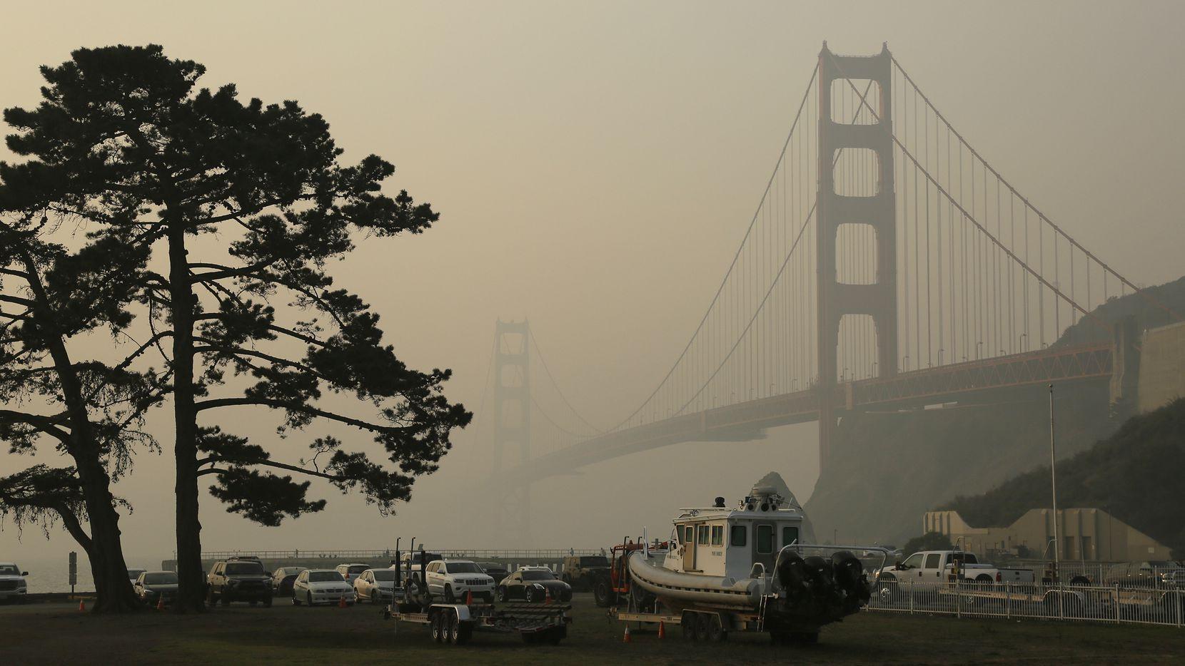 The Golden Gate Bridge is obscured by smoke and haze from wildfires Friday.
