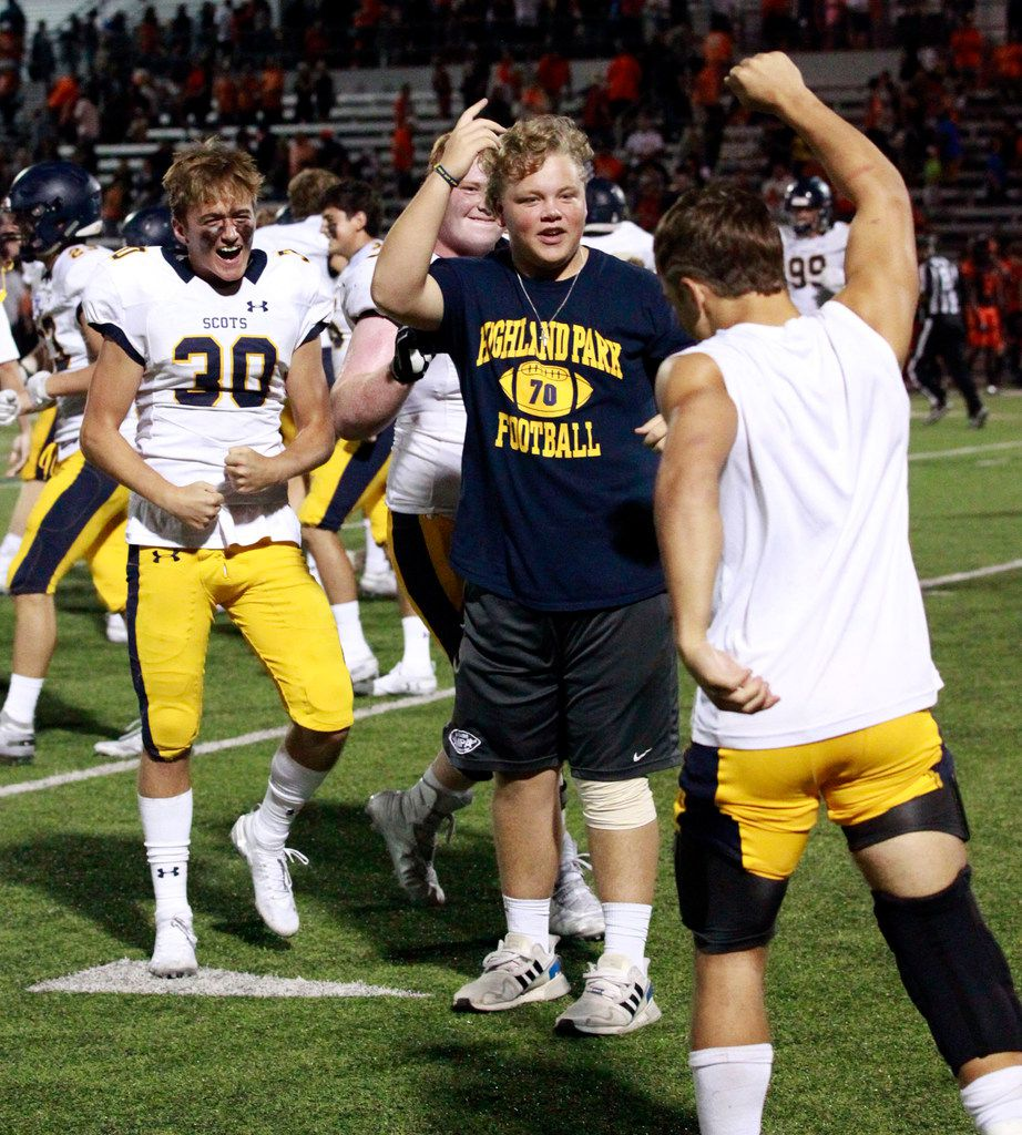 The Highland Park Scots, including James Durand (30) celebrate at the end of their 66-59 win over Rockwall in a high school football game at Wilkerson-Sanders Stadium in Rockwall on Friday, August 30, 2019. (John F. Rhodes / Special Contributor)