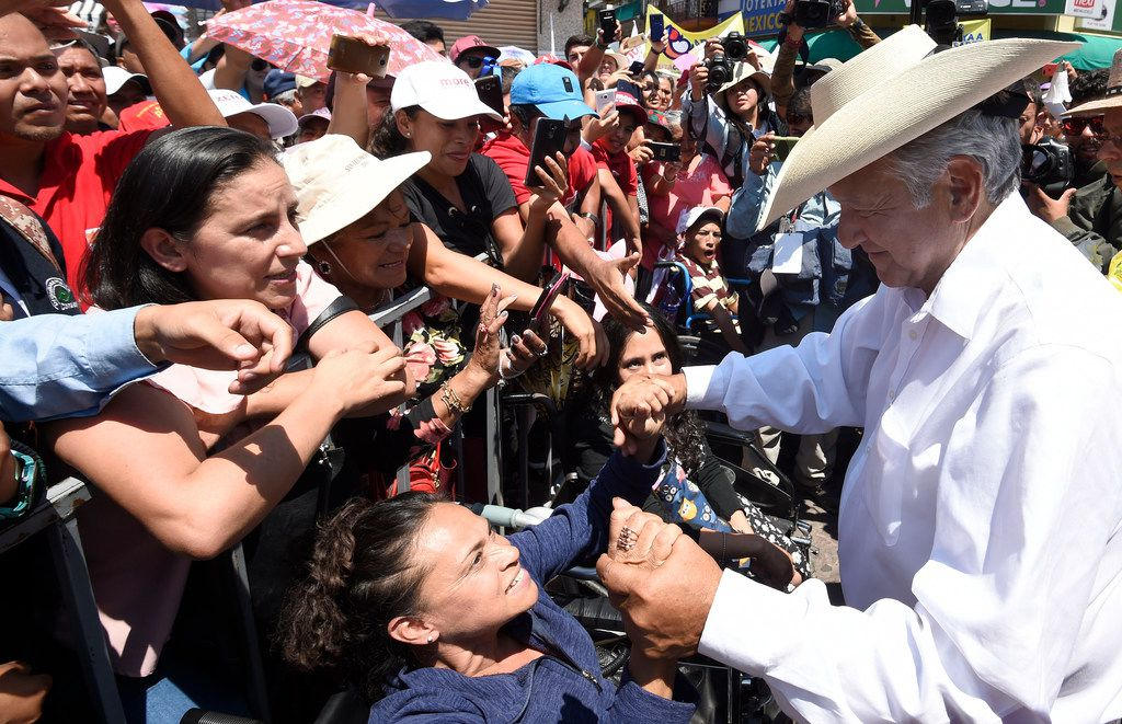 Mexican presidential candidate Andres Manuel Lopez Obrador greets supporters after a campaign rally in Zitacuaro, Michoacan state, Mexico, on May 28. (AFP Photo/Getty Images)