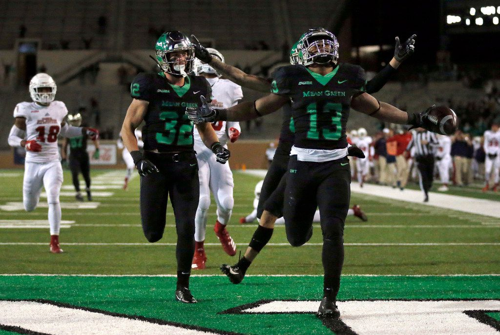 FILE - North Texas Mean Green running back DeAndre Torrey (13) outraced the Florida Atlantic Owls defense for a 92-yard touchdown run in the fourth quarter at Apogee Stadium in Denton, Texas, Thursday, November 15, 2018. (Tom Fox/The Dallas Morning News)