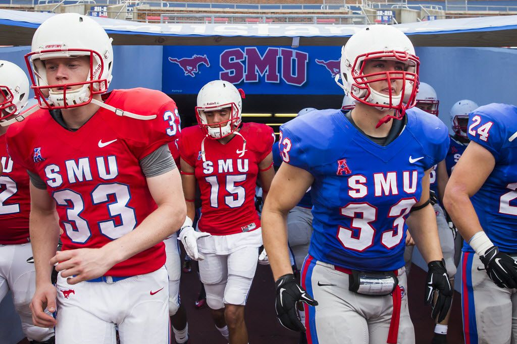 SMU punter Alex Melvin (red #33) and linebacker Matt McNew (blue #33) head to opposite sidelines as they take the field for the team's spring football game at Ford Stadium on Saturday, April 16, 2016, in Dallas. (Smiley N. Pool/The Dallas Morning News)