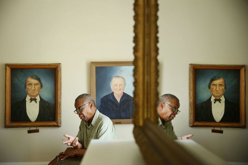 The relatives of Donald Payton were slaves for William Brown Miller in Dallas. The slaves built the Millermore House, which is now located within the Dallas Heritage Village. Donald Payton talks to The Dallas Morning News beside portraits of William Brown Miller and Minnie Miller in the house in 2018.