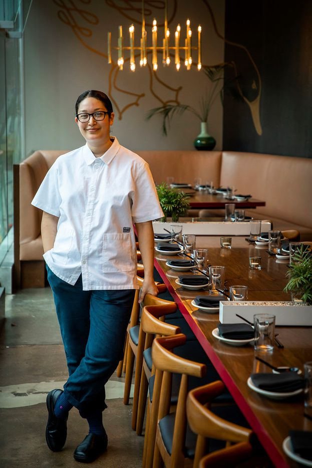 Executive chef Angela Hernandez stands at the long, 28-seat table at Fine China in Dallas.