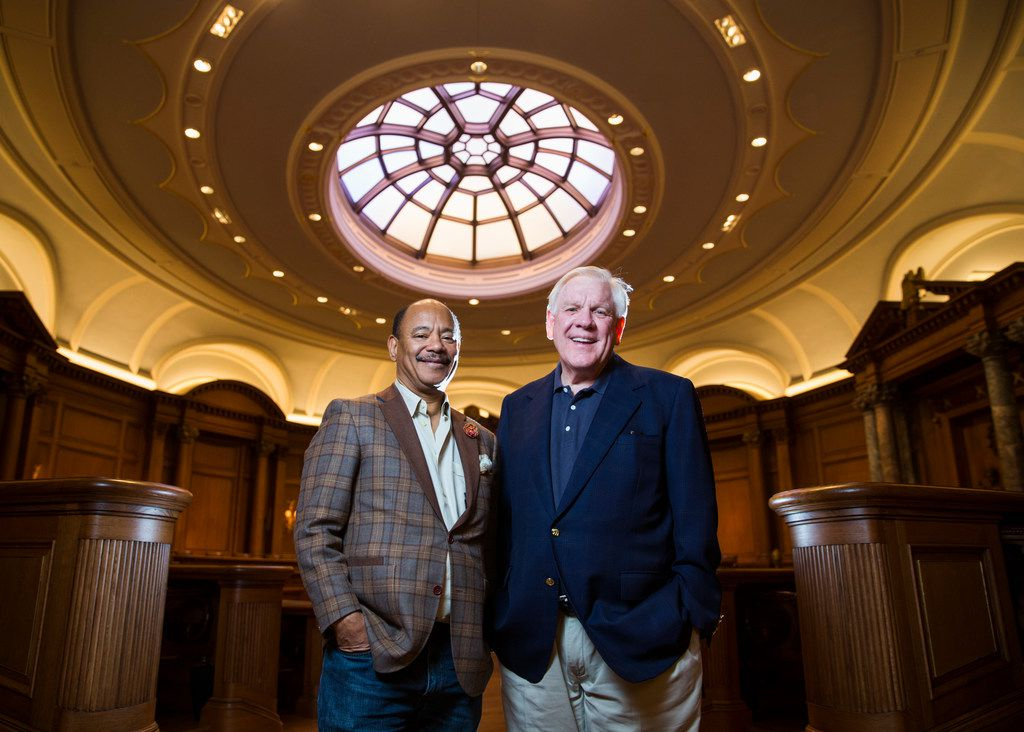 Kneeland Youngblood (left), managing partner at Pharos Capitol Group, and Harlan Crow, chairman of Crow Holdings, pose in the Debate Chamber at Old Parkland.