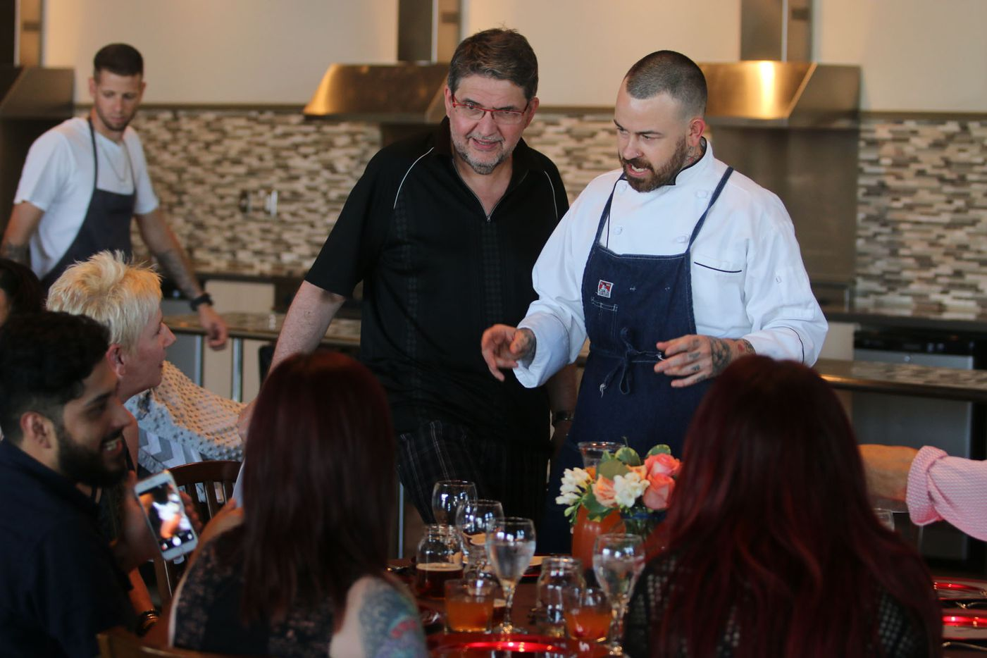 Chef Justin Box chats with guests to his summer pop up dinner Summer Shenanigans at 3015 in Trinity Groves on July 26,2015.