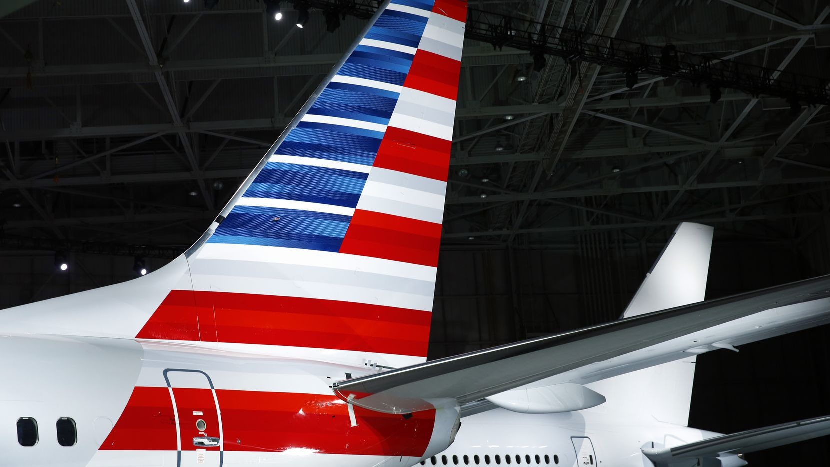 American Airlines Chairman and CEO Tom Horton unveiled the new company logo and exterior on their Boeing 737-800 inside an American hanger at Dallas Fort Worth International Airport, Thursday, January 17, 2013.