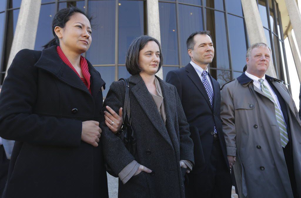 Cleopatra DeLeon (left) and partner Nicole Dimetman, and Victor Holmes and partner Mark Phariss (right) talk with the media after as they leave the U.S. Federal Courthouse on Feb. 12, 2014, in San Antonio. The two couples are challenging Texas' ban on same-sex marriage and have taken their case to federal court. (AP Photo/Eric Gay)