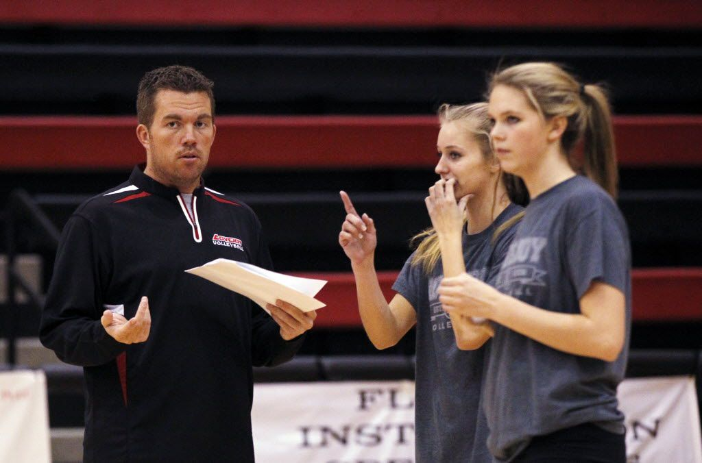 Ryan Mitchell (left) talks to Lovejoy volleyball players during a practice in 2013. (Kye R. Lee/The Dallas Morning News)