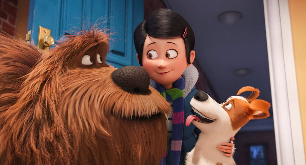 """(L to R) Giant, fluffy, unruly rescue Duke (ERIC STONESTREET), owner Katie (ELLIE KEMPER) and pampered terrier mix Max (LOUIS C.K.) in Illumination Entertainment and Universal Pictures' """"The Secret Life of Pets,"""" a comedy about the lives our pets lead after we leave for work or school each day."""