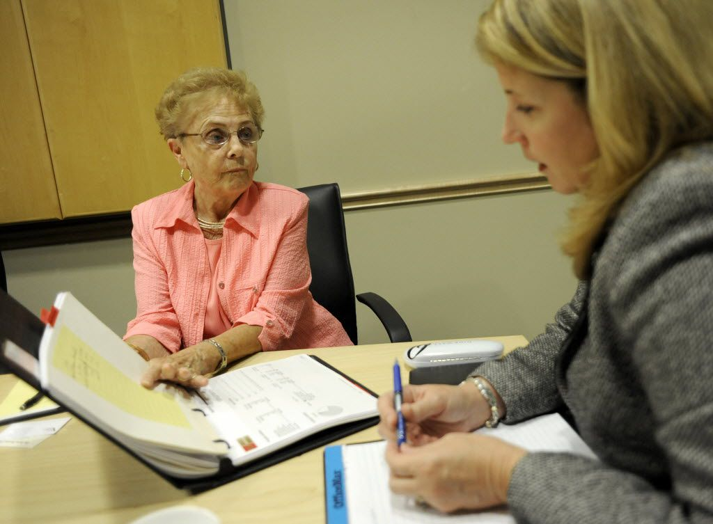 Doreen Cluck goes over her financial portfolio with financial planner Jan Valecka in 2010.