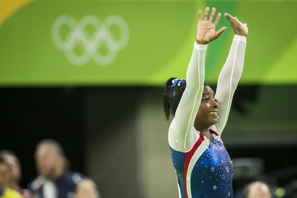 Simone Biles of the United States waves to the crowd after winning the women's gymnastics all around final at the Rio 2016 Olympic Games on Thursday, Aug. 11, 2016, in Rio de Janeiro.  Biles won the gold.  Aly Raisman took silver. (Smiley N. Pool/The Dallas Morning News)