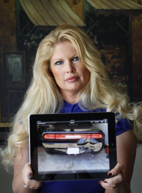 Denise Washburn's 2013 Dodge Challenger was rear-ended by a car traveling 40 mph in Arlington, a city cited by an Allstate Insurance Co. study for its bad drivers. Washburn is still dealing with injuries from the crash.