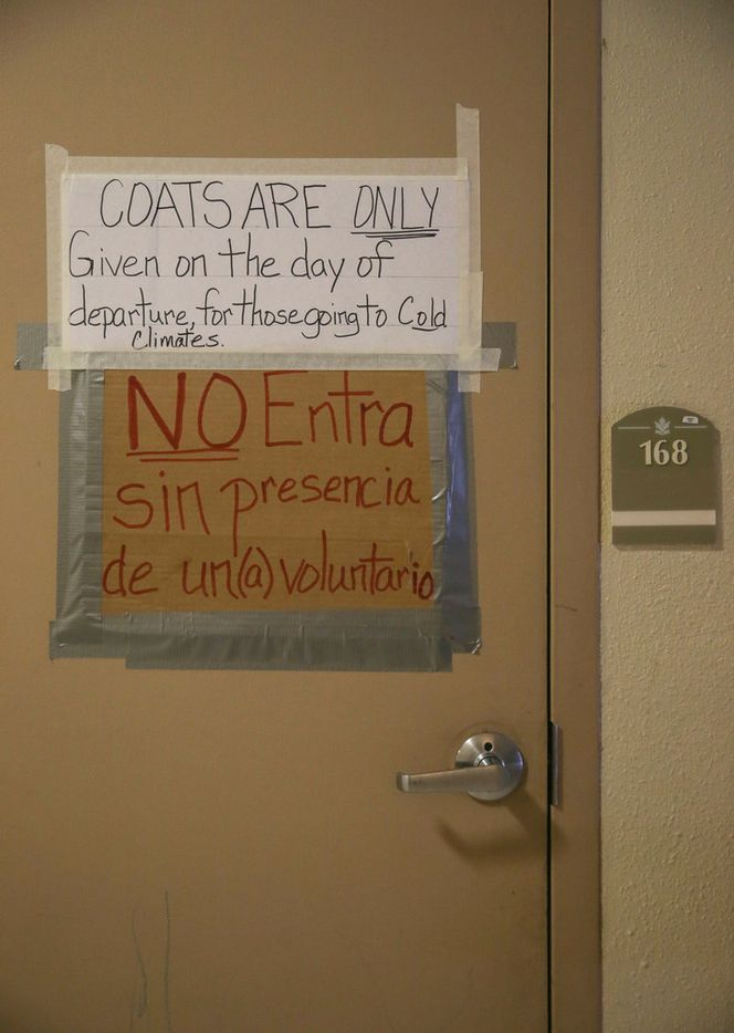 A sign hangs from the coat closet door at an Annunciation House shelter on Friday, March 29, 2019 in El Paso, Texas. Annunciation House is an El Paso nonprofit organization that has sheltered migrants for more than 40 years.
