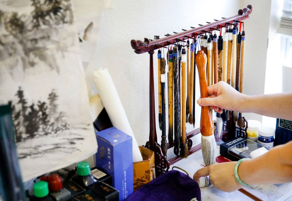 Local artist Jenney Chang uses various brushes for her Chinese paintings at her Plano home studio. Chang has taught Chinese painting in the Dallas-Fort Worth area for over two decades.
