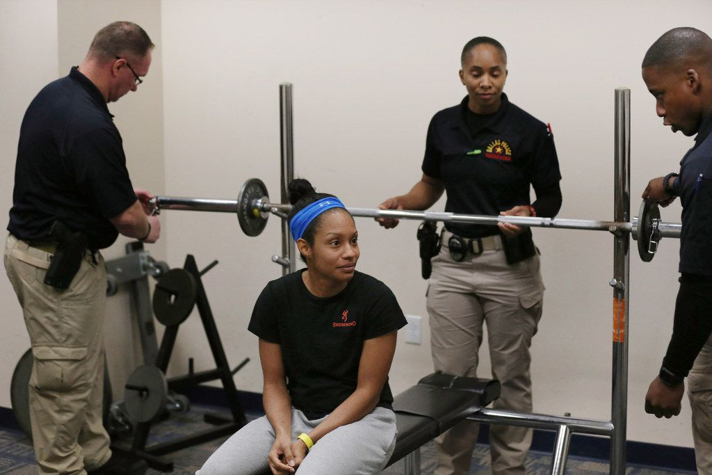 Recruits pulled for one another during the bench press, helping Amanda Martin breeze through with a 60-pound lift.