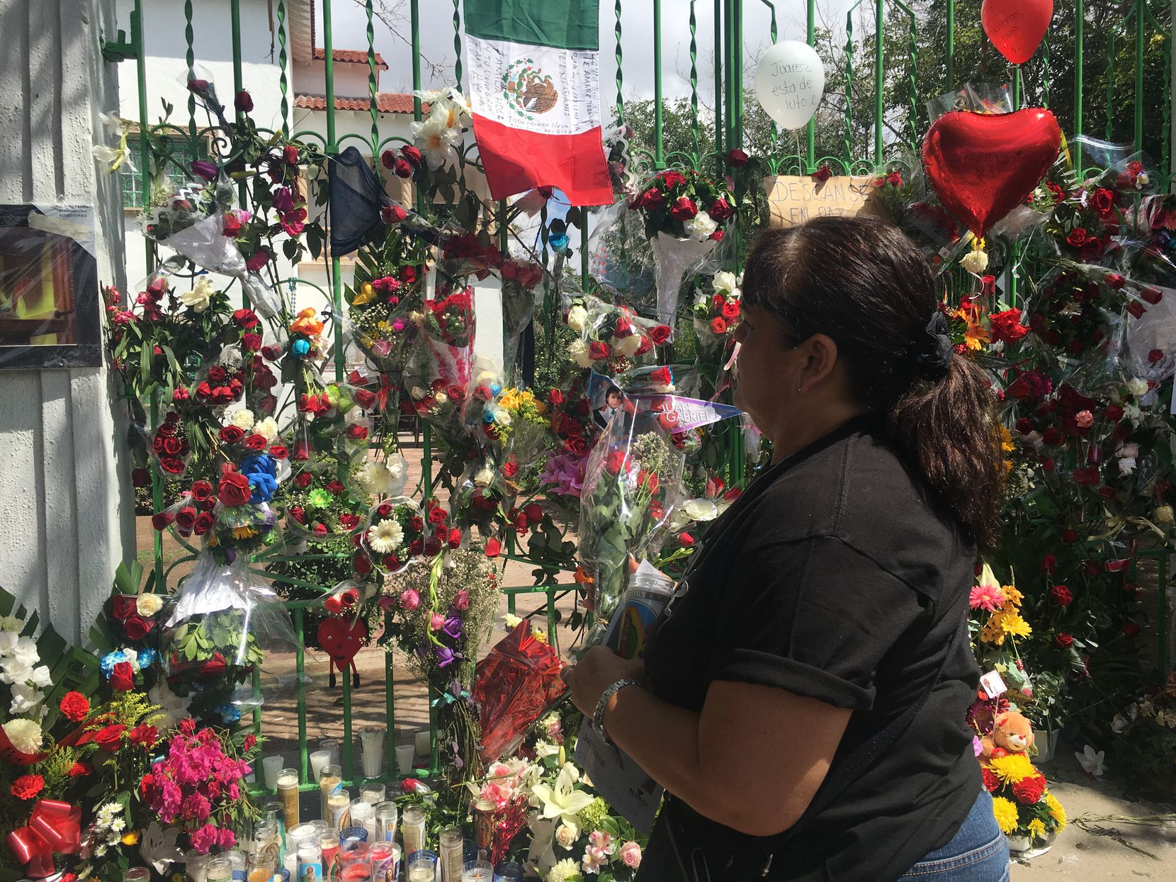 Mourners placed flowers outside a home owned by singer Juan Gabriel in Ciudad Juarez, the border city where the iconic singer started out as a street musician.