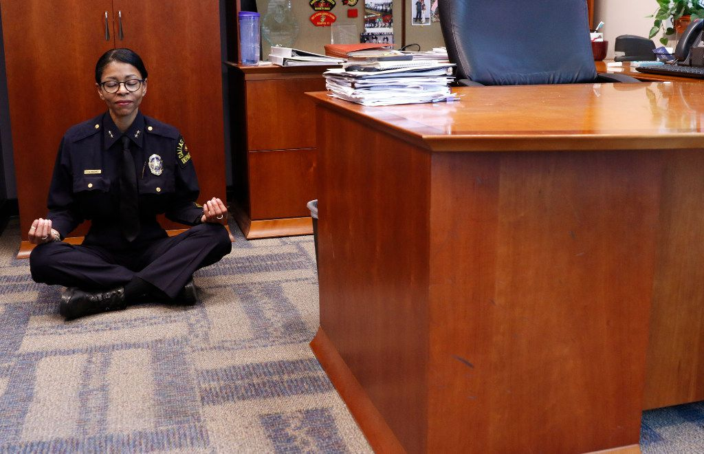 DPD Assistant Chief Tammie Hughes demonstrates how she meditates in her office at the Dallas Police Department headquarters in Dallas, Monday, July 31, 2017. The Center for BrainHealth at the University of Texas at Dallas offering mindfulness and brain health training for Dallas police officers, to help the officers juggle their work and personal lives.  (David Woo/The Dallas Morning News)
