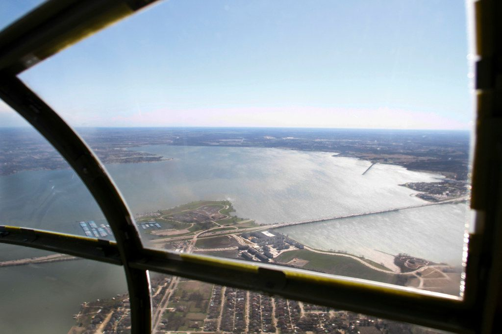 The view from the bombardier/navigator seat in the front nose of a North American B-25 Mitchell Bomber as the plane flies over Lake Ray Hubbard during a media flight on Wednesday, March 13, 2019. The bomber is part of Collins Foundation's Wings of Freedom Tour at the Frontiers of Flight Museum.