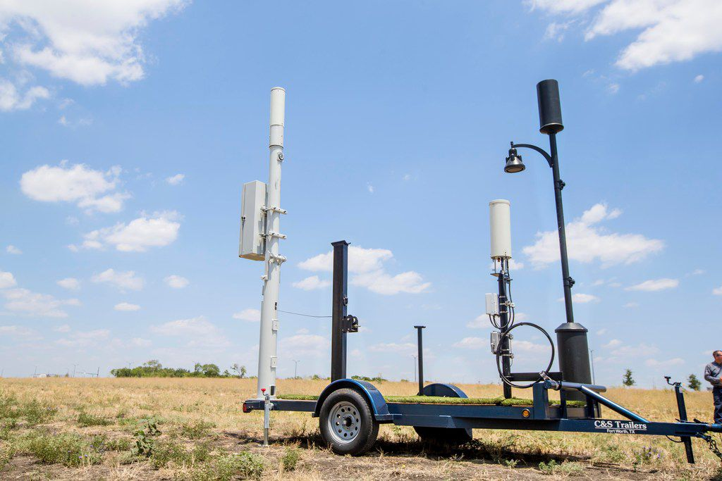 These are three different versions of the wireless small cells, also called CRAN nodes, that AT&T will place throughout Frisco Station. Some, like the one on the left, will be more industrial-looking. Others will look like the one on the right, which is attached to a streetlight. (Carly Geraci/The Dallas Morning News)
