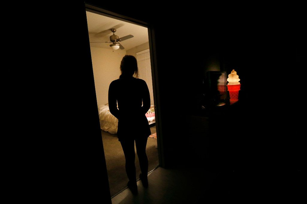A 19-year-old woman is suing Lewisville ISD in federal court, accusing the school district of retaliating against her when she reported that two Hebron football players raped her at a house party when she was a freshman. She poses for a photograph at her home, Friday, March 10, 2017. (Tom Fox/The Dallas Morning News)