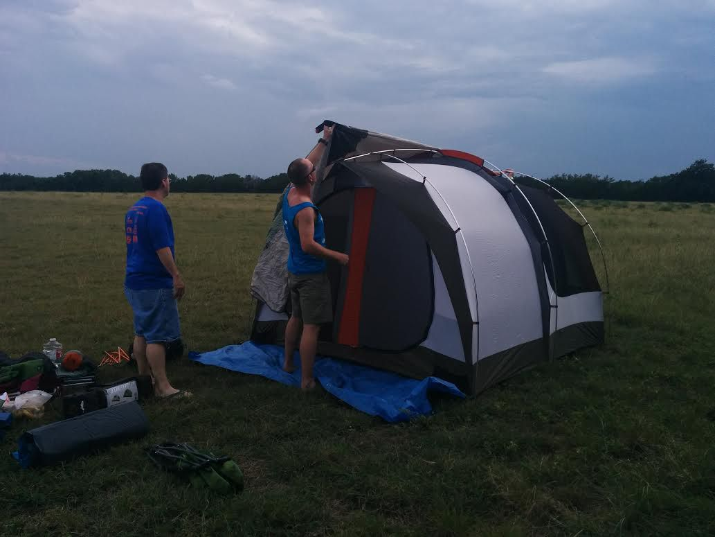 Steve Jones and Matt Florence set up a tent prior to the race's 7:15  p.m. start.