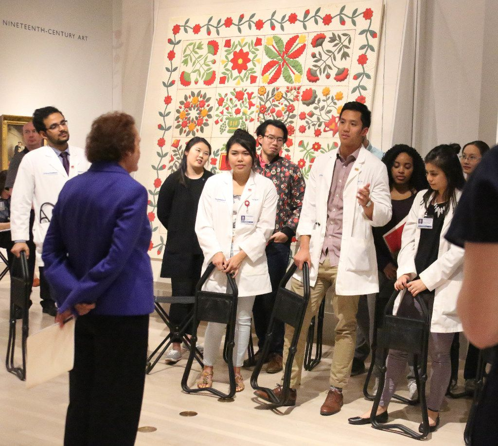 """Bonnie Pitman of UT Dallas talks with UT Southwestern Medical School students about items at the Dallas Museum of Art, in a program called """"Art of Examination,"""" which explores ways in which the DMA's collections can help students improve their observation/diagnostic skills as future doctors."""
