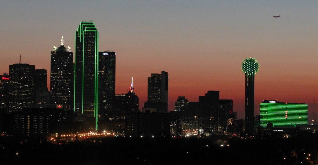 Several buildings in downtown Dallas are lit in green to celebrate Saint Patrick's Day on Monday, March 17, 2014.