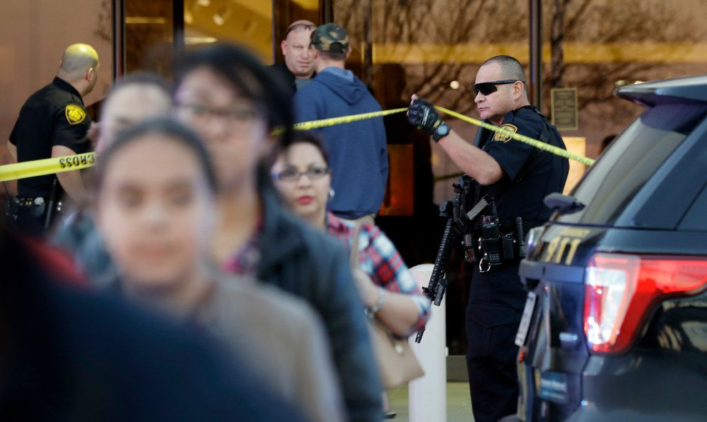 San Antonio police help shoppers exit the Rolling Oaks Mall after a deadly shooting Sunday.