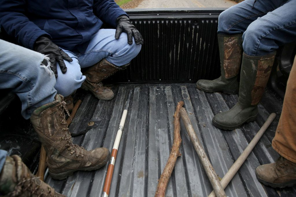 The volunteer search team rode in the back of a pickup during a weekly search for the remains of Christina Morris in an area of northern Collin County in December 2016.
