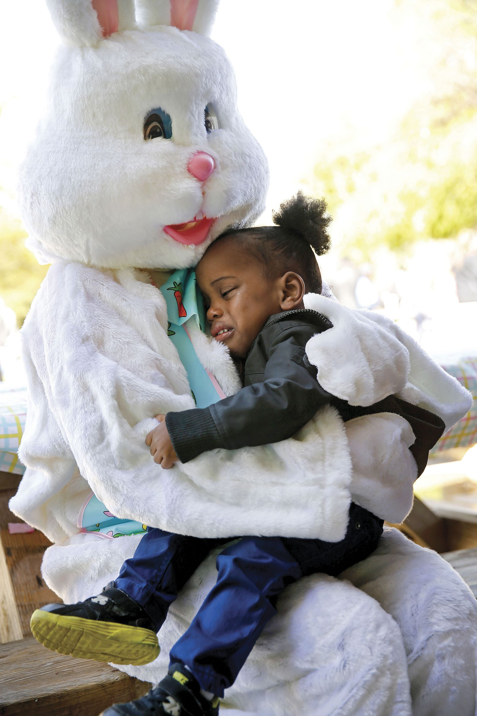 The Easter Bunny comforted Zayne Douglas, 3, of Dallas, a visually impaired boy who was upset by party noise, at White Rock Lake on March 24. The Dallas Independent School District held their annual Beeping Easter Egg Hunt for visually- and hearing- impaired children of low-income Dallas families.