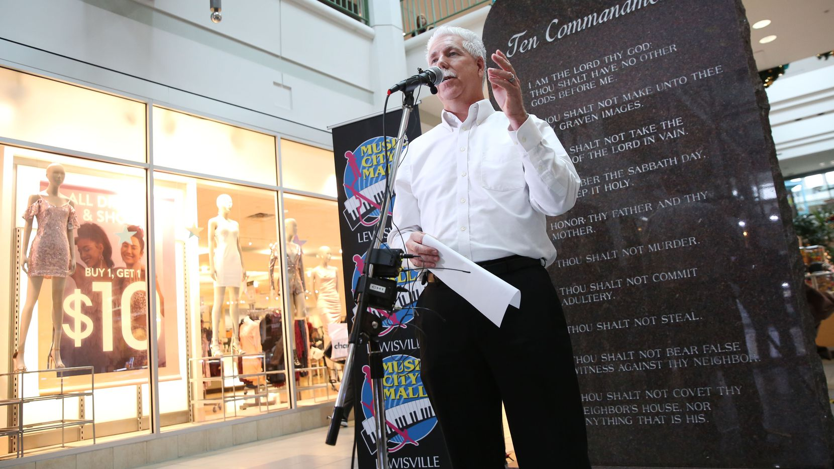 Richard Morton, general manager of Music City Mall, speaks during the unveiling of a Ten Commandments monument at the mall in Lewisville, Texas on Friday, Dec. 29, 2017. The Ten Commandments will be featured year-round in the lower level of the mall, while a second stone tablet with two commandments will be displayed on an upper level entrance. (Rose Baca/The Dallas Morning News)