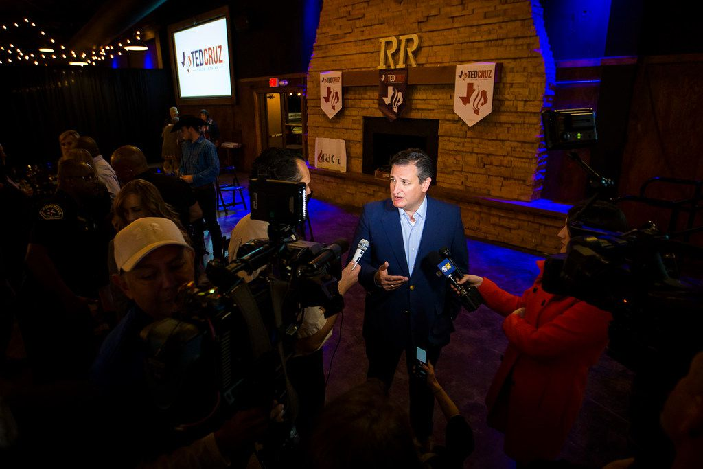 Sen. Ted Cruz talks with reporters following a campaign event at River Ranch Stockyards on Wednesday, April 4, 2018, in Fort Worth, Texas.