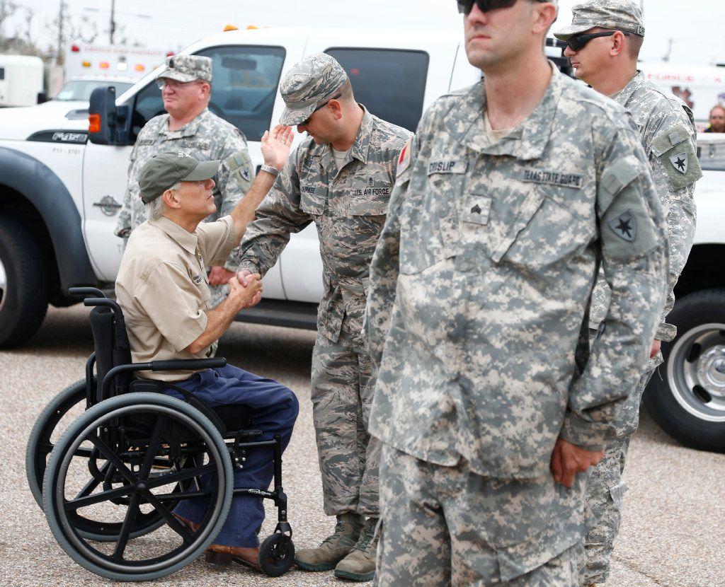 Gov. Greg Abbott shakes hands with National Guardsmen after Hurricane Harvey hit Rockport. (Nathan Hunsinger/Staff Photographer)