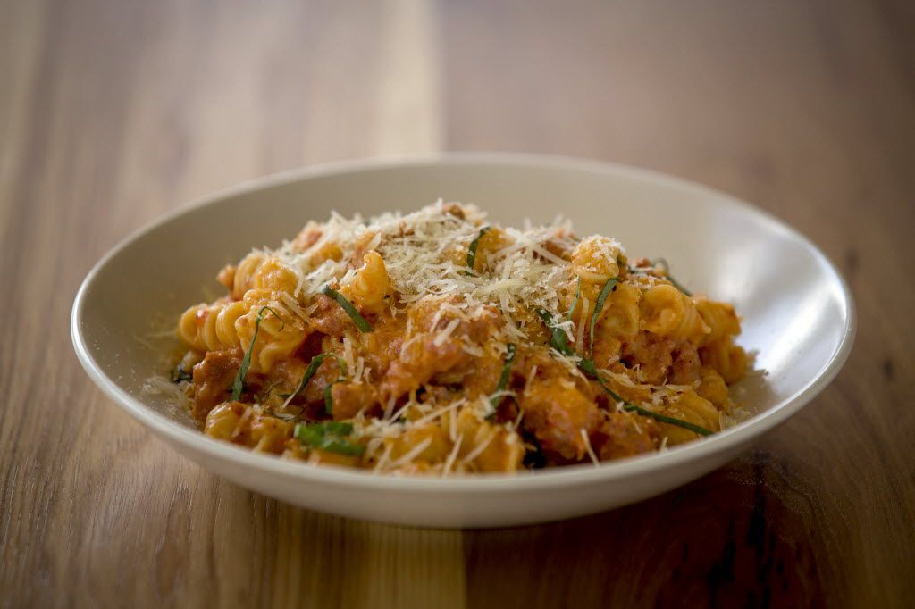 Fusilli with sausage, ramps and escarole in a brandy-touched creamy sauce