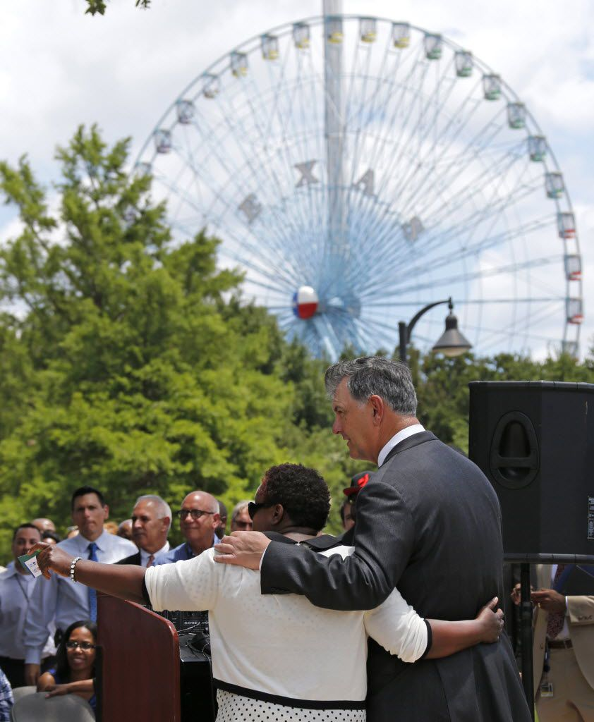Dallas Mayor Mike Rawlings (right) and the Dallas City Council's Carolyn R. Davis join forces to announce plans to enhance the aesthetic appeal and improve the economic viability of businesses located in the South Dallas/Fair Park area,  at a press conference at Fair Park in Dallas,Texas on Tuesday, June 10, 2014.