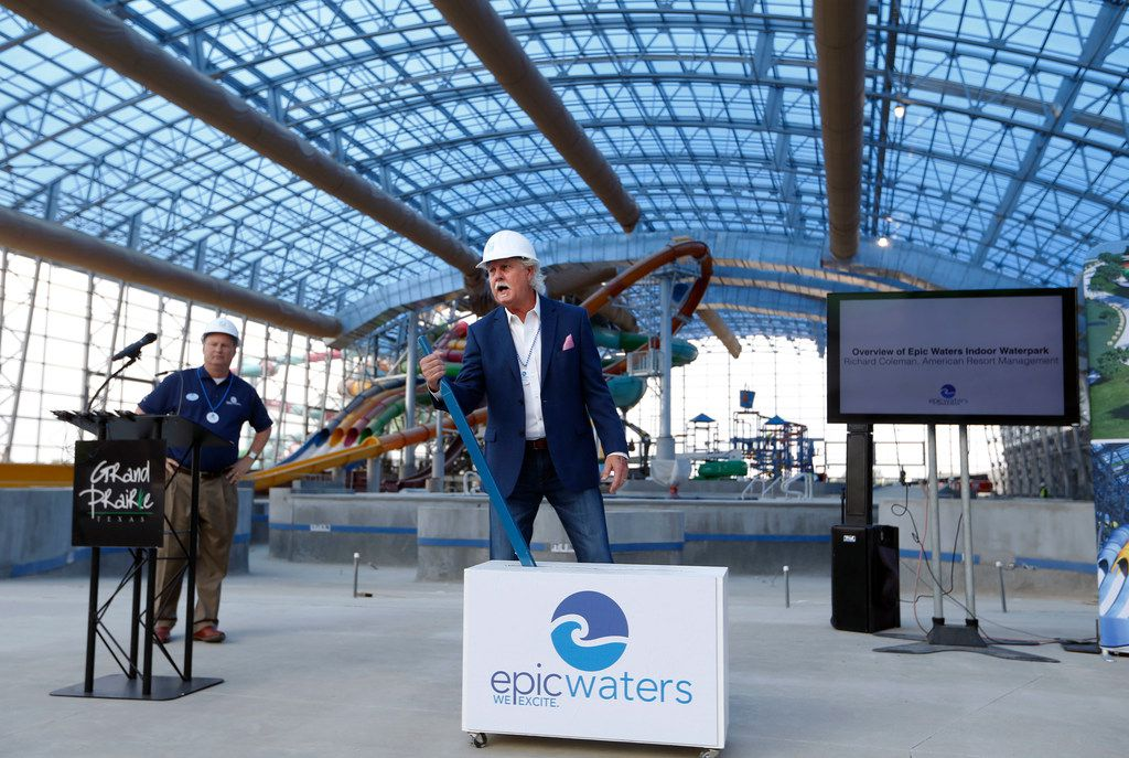 Grand Prairie Mayor Ron Jensen flips a switch representing the switch for the retractable roof during a press conference at Epic Waters Indoor Waterpark in Grand Prairie on Tuesday, October 3, 2017. The park is still under construction and scheduled to open later this year. (Vernon Bryant/The Dallas Morning News)