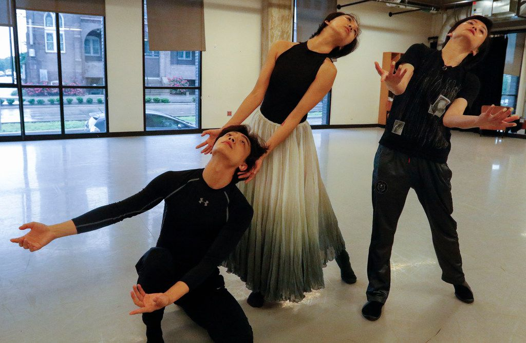 Beijing Dance Theater artistic director Wang Yuanyuan, right, rehearses company members Zheng Jie, left, and Feng Linshu, middle, at Booker T. Washington High School for the Performing and Visual Arts for the TITAS Command Performance premiere of Wang's duet Beyond the Smoke.