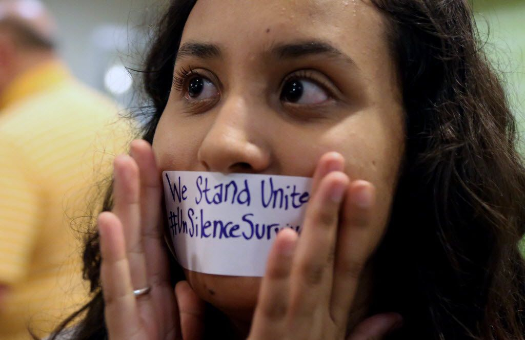 Baylor junior Julieth Reyes cover her mouth with tape during a rally against sexual assault at Baylor on Friday, June 3, 2016.