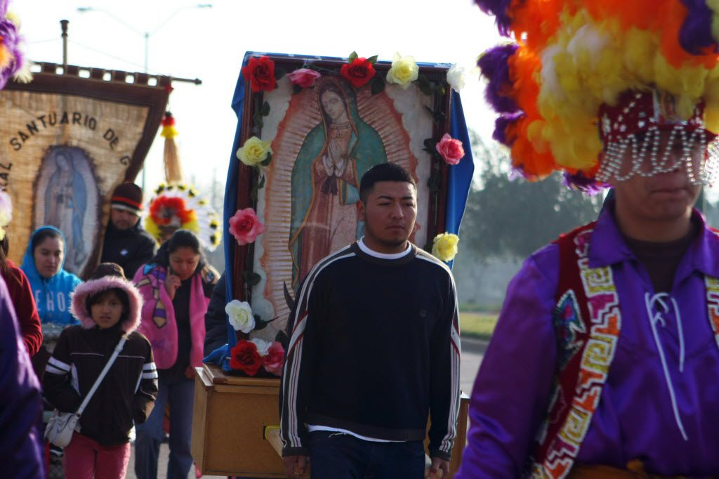 Ramiro Lopez, 29, carries an image of Our Lady of Guadalupe during the Pastoral Juvenil's pilgrimage from St. Cecilia to the Cathedral in celebration of Our Lady of Guadalupe, on Dec. 10, 2011 in Dallas.